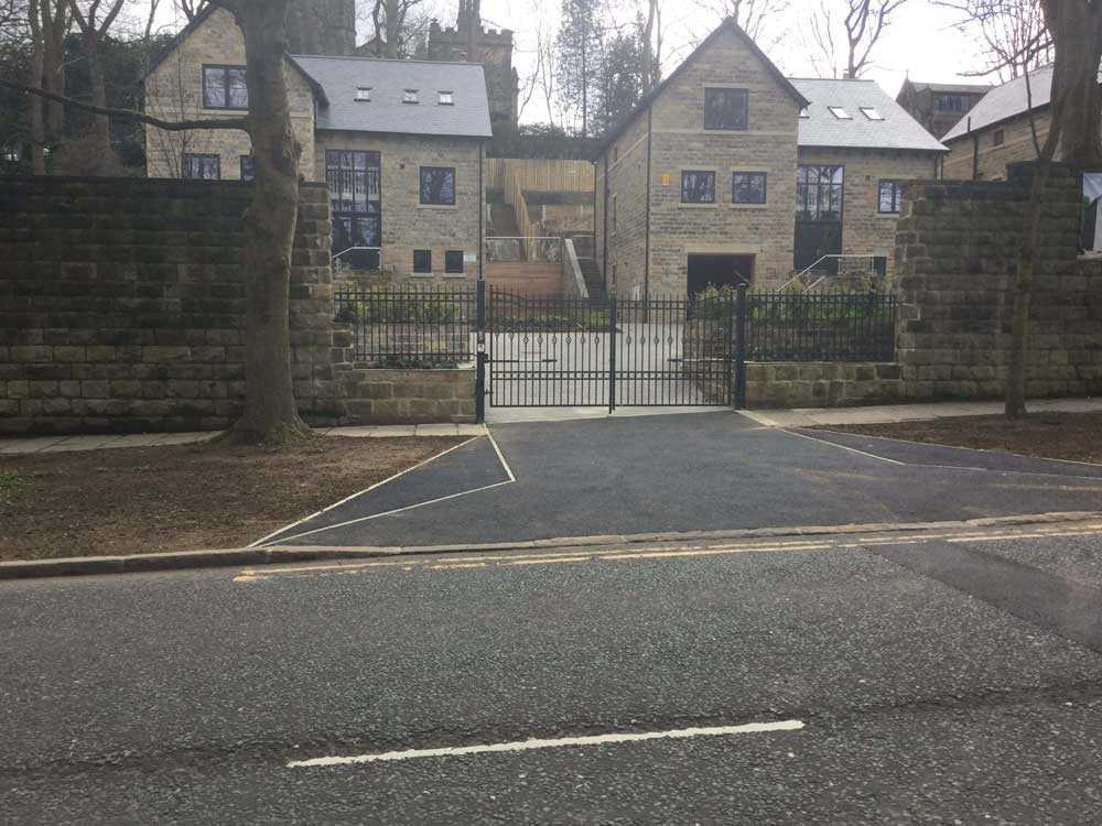 Sectional Garage Doors and Automated Metal Gates for a Small Housing Development, Leeds