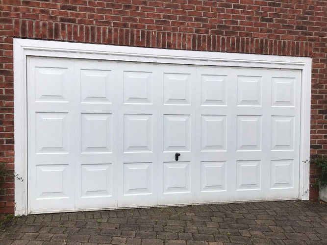 Insulated Ribbed Sectional Garage Door with Rectangle Windows, Bolton