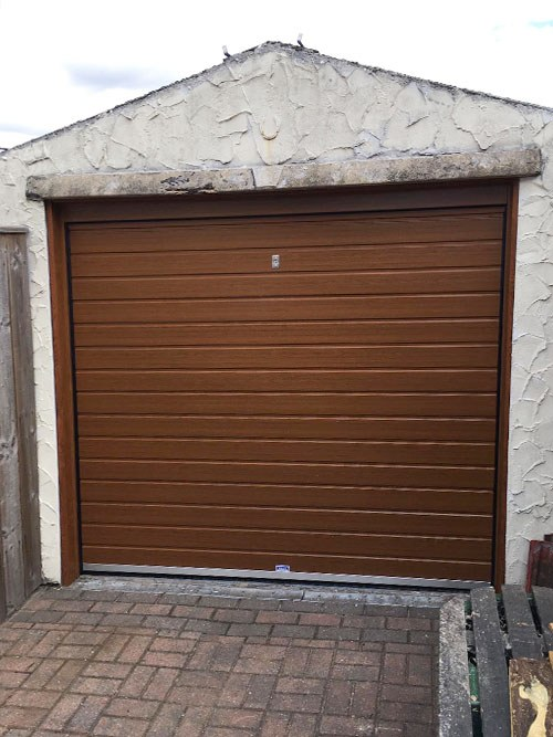Standard Rib insulated Sectional Garage Door in Golden Oak, Bolton