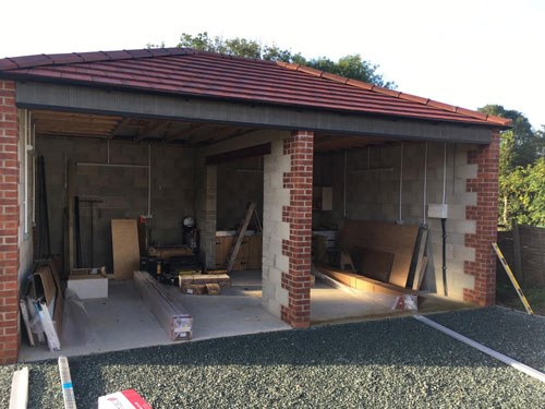 L-Rib Insulated Ribbed Sectional Garage Doors for New Build, Leeds