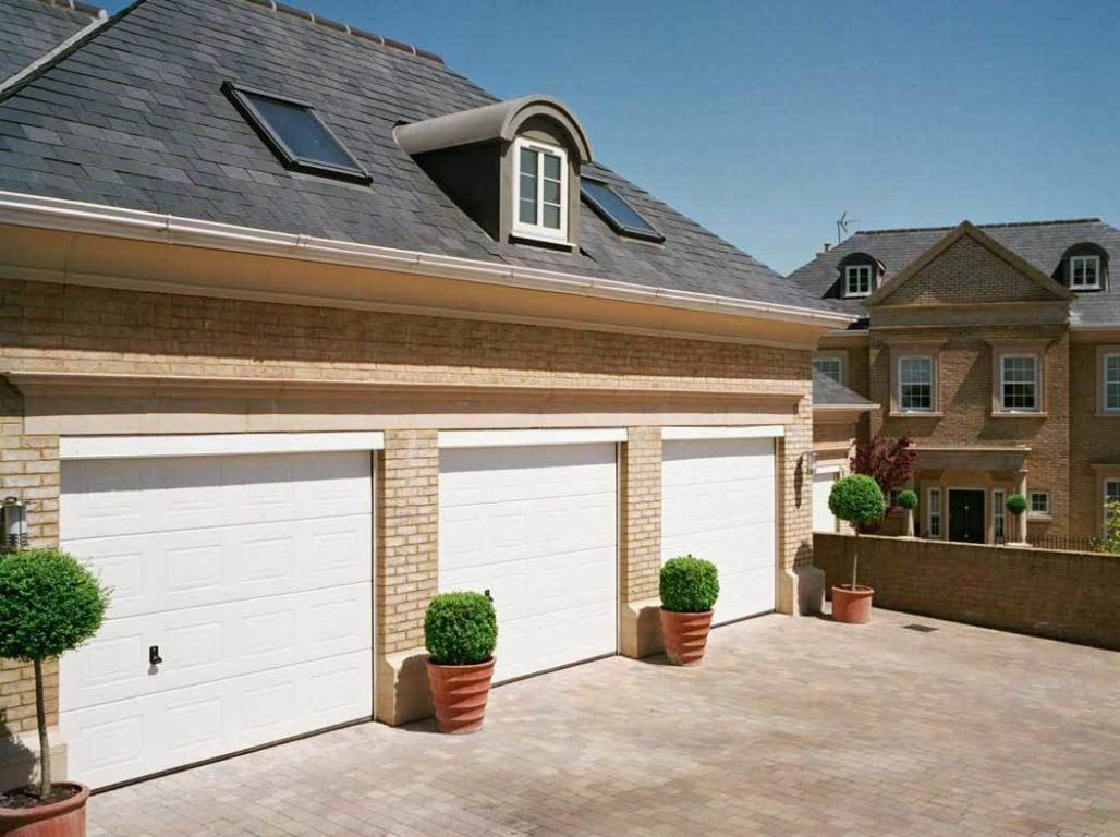 A trio of Oxley Georgian insulated sectional garage doors in white