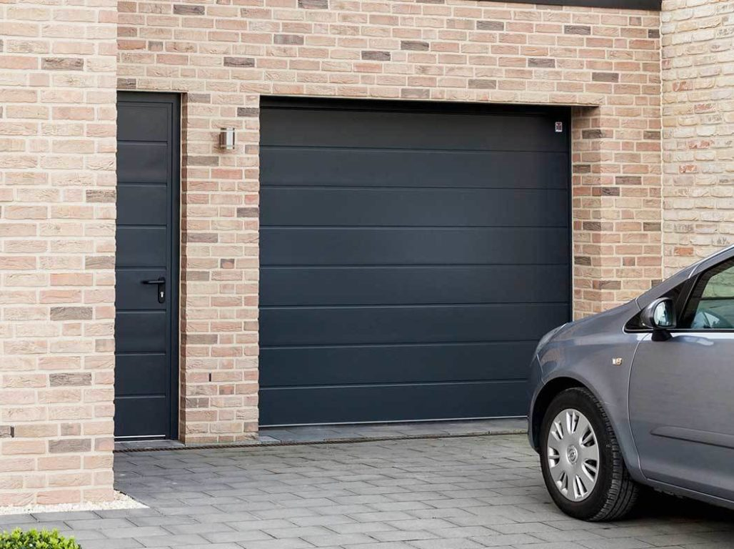 Oxley Centre Ribbed sectional garage door finished in Anthracite Grey