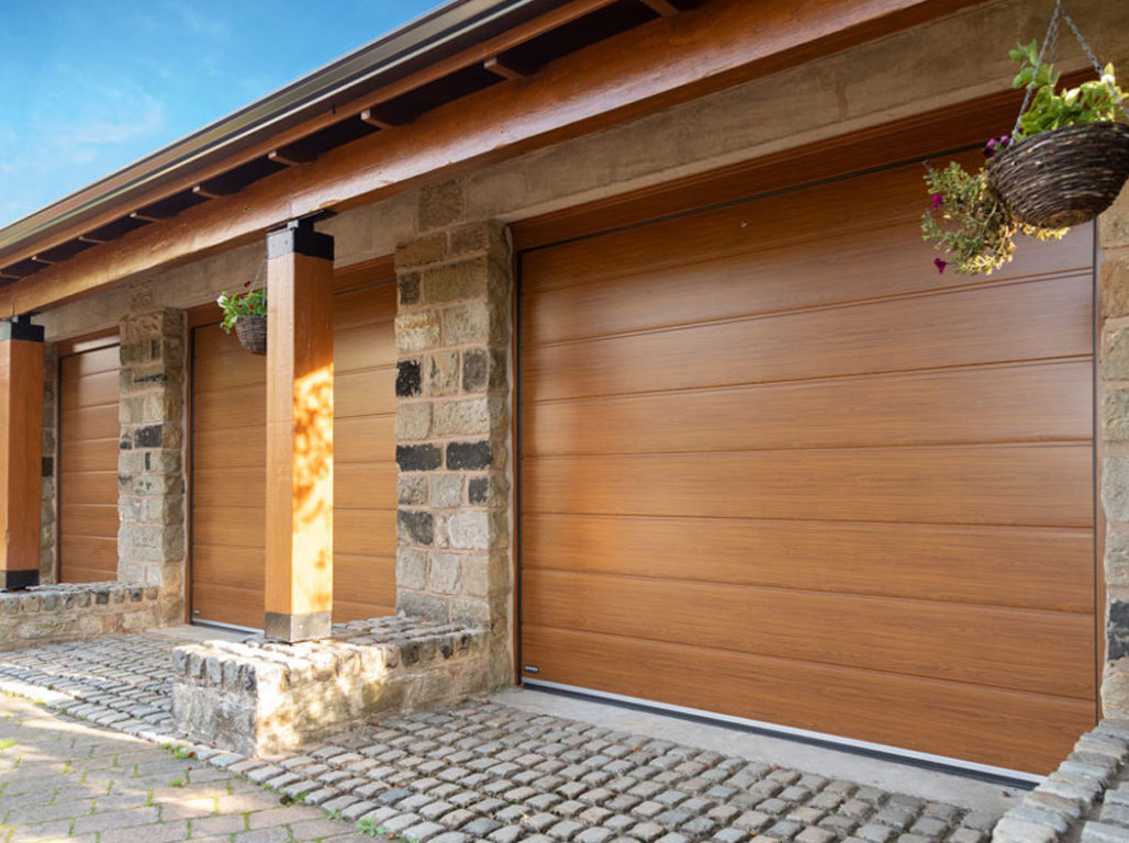 Oxley Centre Ribbed sectional garage door finished in Golden Oak