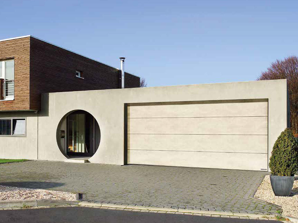Oxley designer insulated sectional garage door finished in Concrete effect