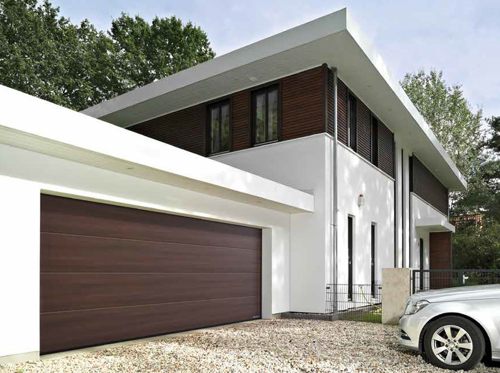 Oxley Designer Insulated Sectional Garage Doors Finished in Terra Walnut