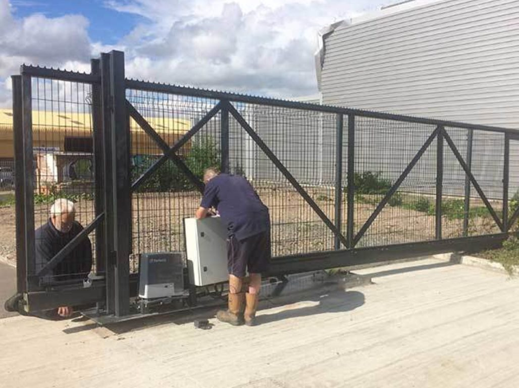Staff installing an Oxley cantilever sliding automatic gate for a local factory in Hull