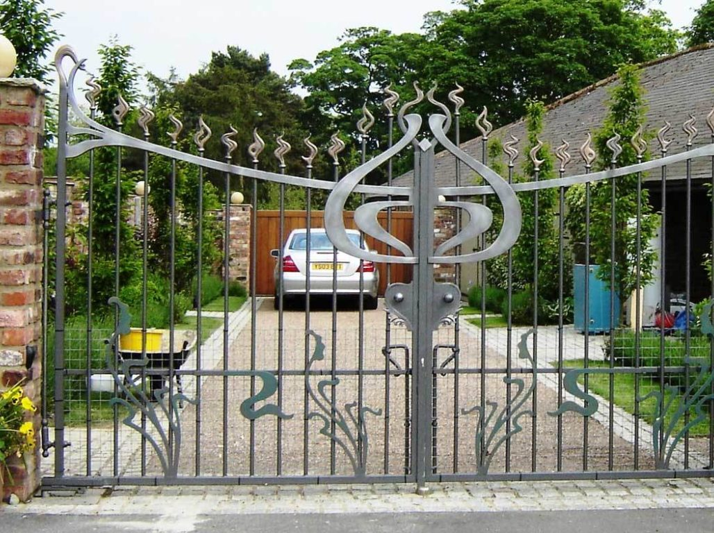 Art Nouveau inspired bespoke gate design - Beautifully finished in a pewter effect with bronzed detailing