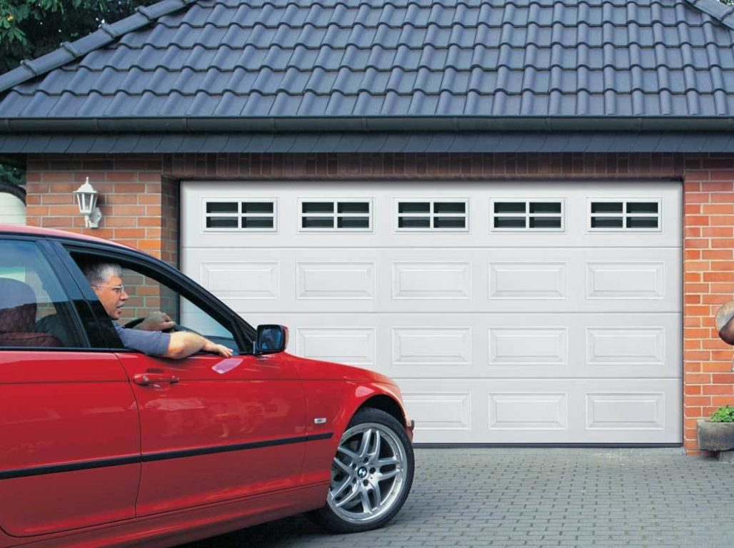 Oxley Georgian insulated sectional garage door in white with cross mullion windows