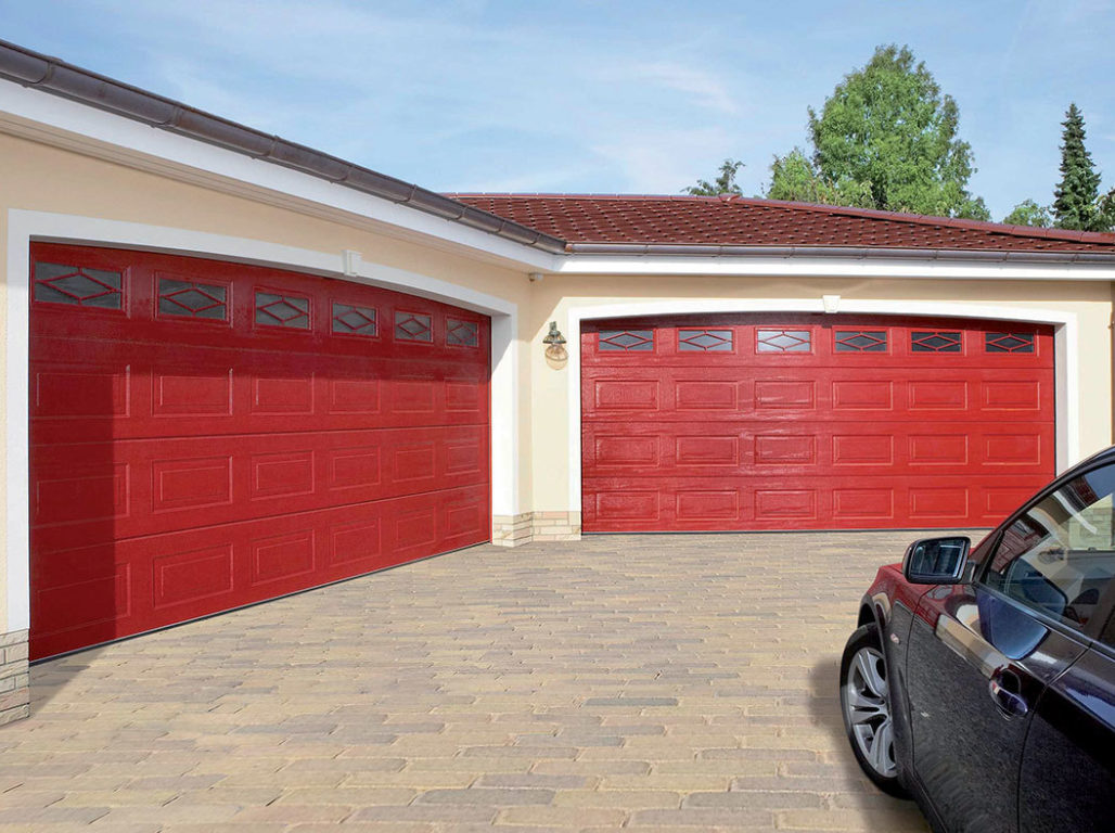 Oxley Georgian sectional garage door finished in Flame Red with Diamond Mullion Windows
