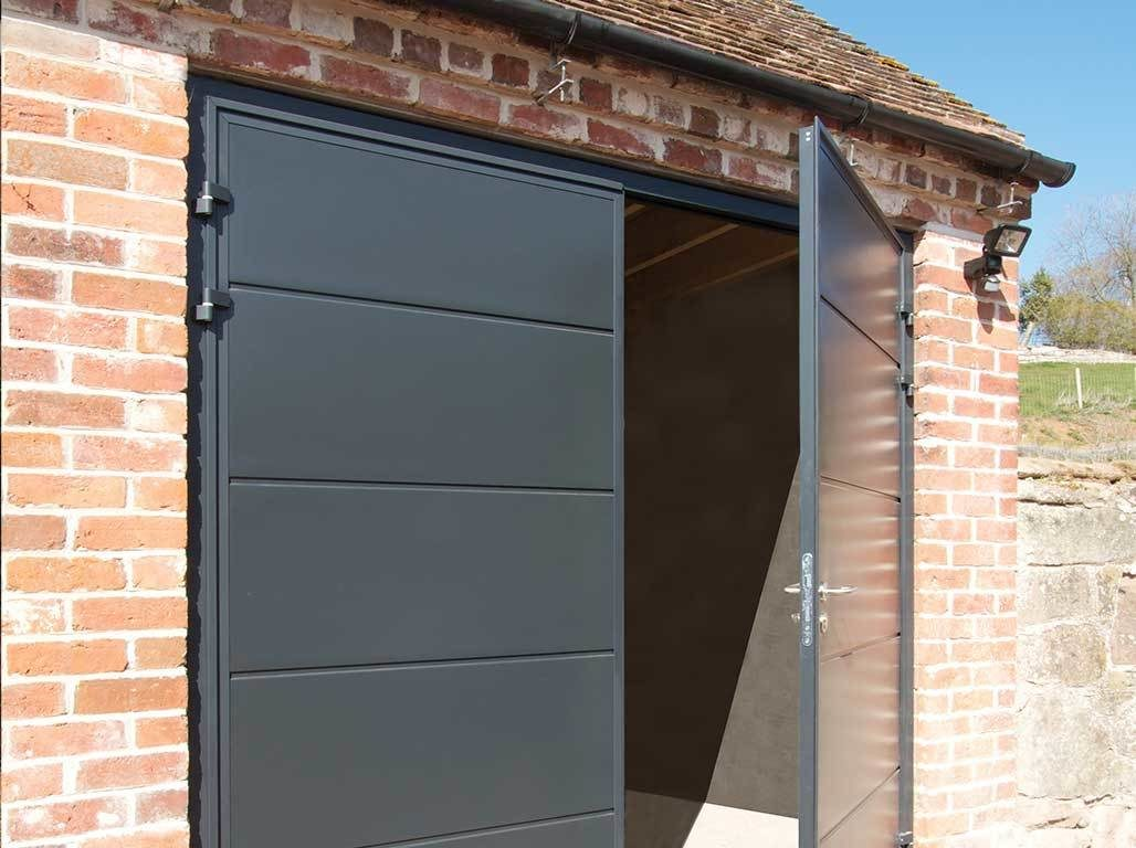 Oxley Insulated side hinged garage door solid panel design in Anthracite Grey