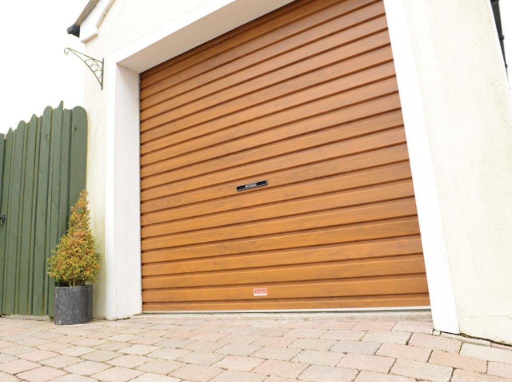 Oxley Single skin steel roller garage door in Golden Oak