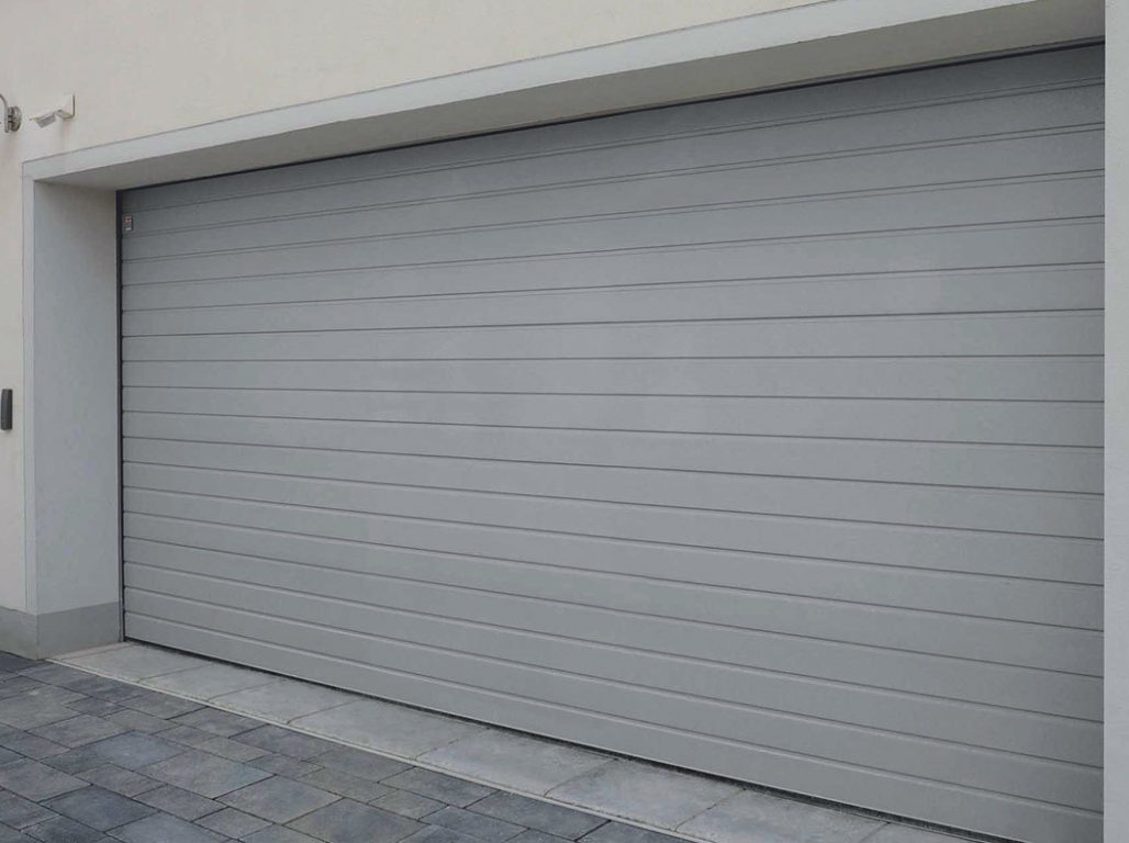 Oxley Standard Ribbed sectional garage door finished in Light Grey