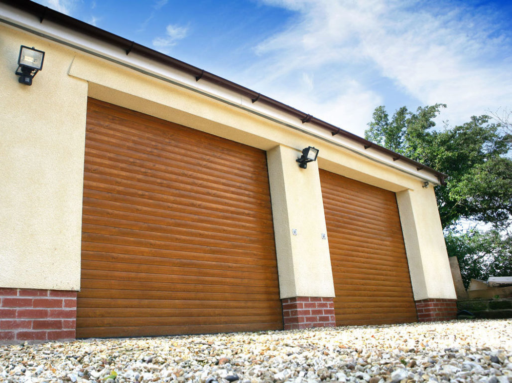 Oxley insulated twin roller garage doors finished in Golden Oak