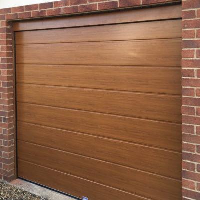Insulated Sectional Garage Door in Golden Oak, Preston
