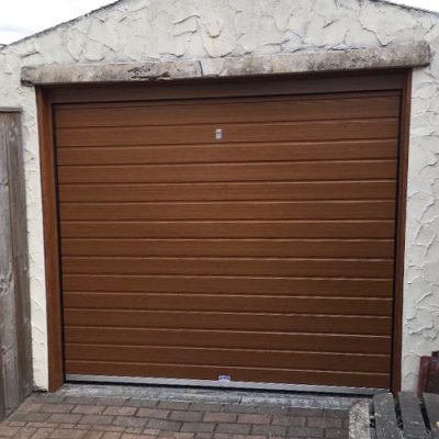 Standard Rib insulated Sectional Garage Door in Golden Oak, Bury