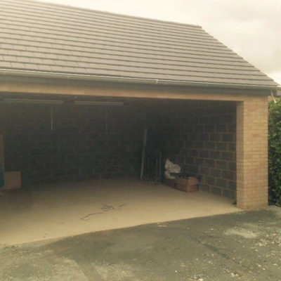 L-Rib Insulated Sectional Garage Door, Hull